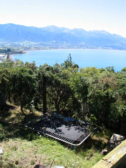 Trampoline, bay and mountains